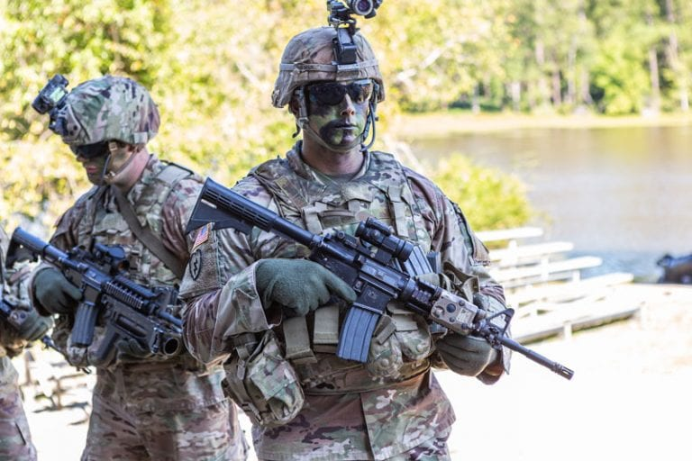 Soldiers in camo during training